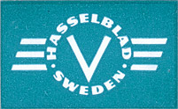 "The ""HASSELBLAD SWEDEN"" winged-V logo as it appeared on the box of an ""EXTENSION TUBE No. 20"", dating from the 1950-1957 period."